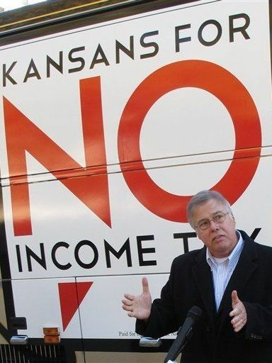 n Kansas, legislators are considering devoting extra funds to tax relief instead of hiring more state workers. Republican state Rep. Joe Patton of Topeka, shown in November, talks about proposals to eliminate the state's income tax.
