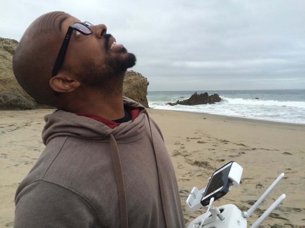 Brennon Edwards watches his drone fly a pre-programmed route as it photographs the Malibu coastline. The pictures will help scientists predict future ocean levels.