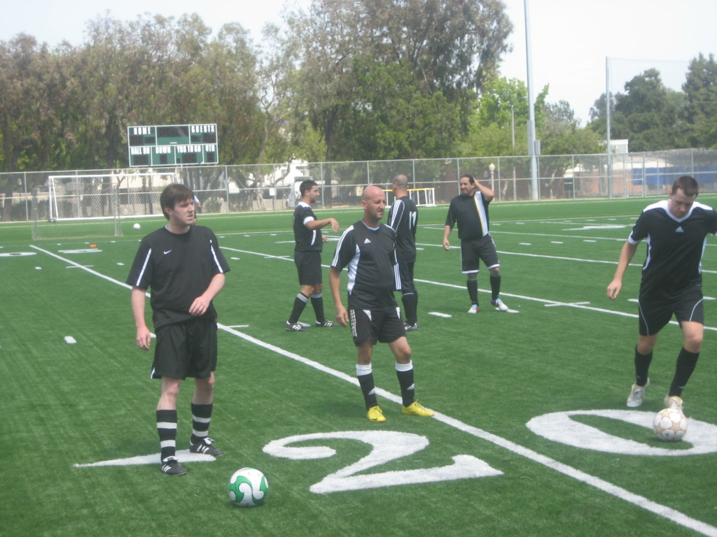 Members of the Footballers United team warm up before a Sunday match in the Pasadena Adult Soccer League