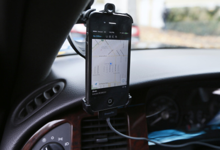 The transportation app Uber matches ride-seekers with drivers.