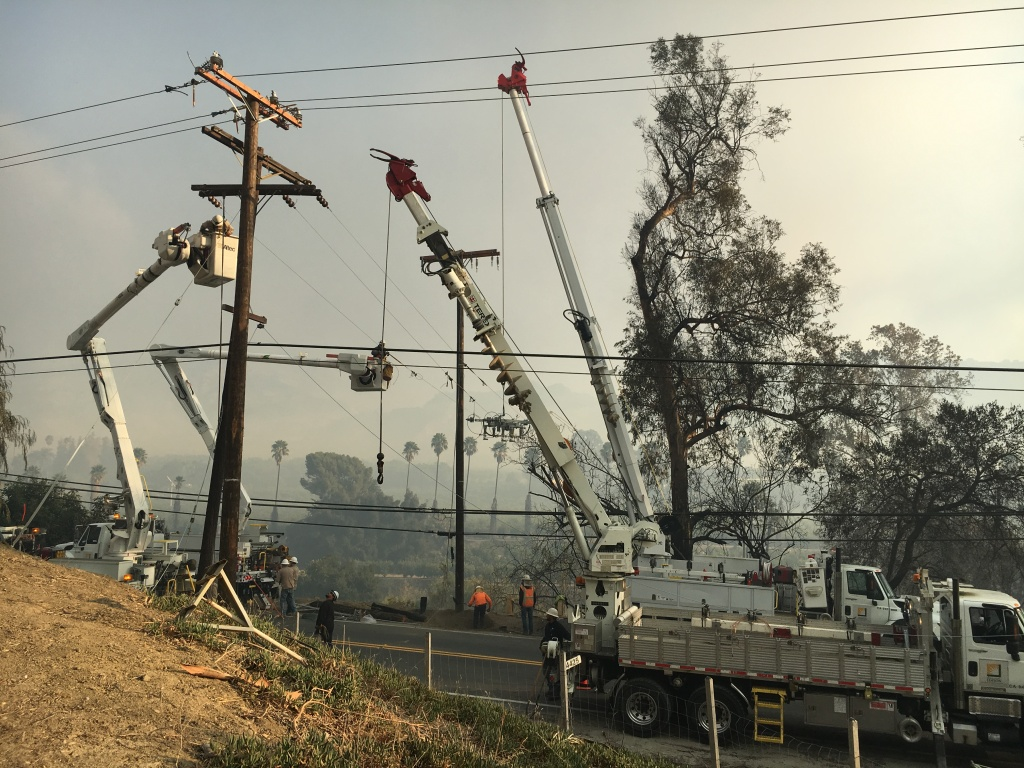 Repair crews replacing power poles and electrical lines that were burned in the Thomas Fire along Highway 150 north of Santa Paula Dec. 6, 2017.
