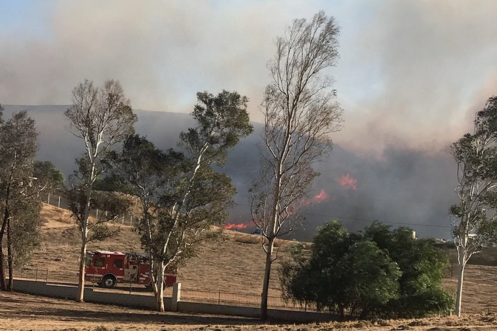The Liberty Fire started on Thursday afternoon and was holding at 300 acres Friday morning, with 60 percent containment. The fire destroyed at least one structure and six outbuildings, according to Murietta Fire and Rescue.