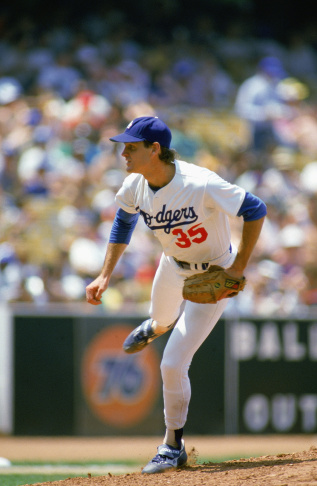 In this Oct. 4, 1978 file photo, Los Angeles Dodgers pitcher Bob Welch winds up to throw to the Philadelphia Phillies in a National League playoff game at Philadelphia. Welch, former All-Star pitcher with the Los Angeles Dodgers and the Oakland Athletics has died.  The two-time All-Star and Cy Young award winner was found dead at his home. He was 57.