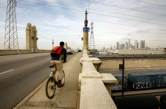 A bicyclist crosses the 4th Street Bridge over the Los Angeles River. File photo.