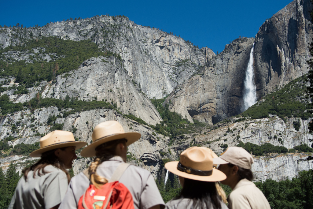 Park rangers meet in front of Yosemite Falls on June 18, 2016 in Yosemite National Park, California.