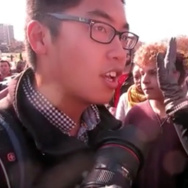 "In this Nov. 9, 2015 frame from video, Janna Basler, right, who works in the University of Missouri's office of Greek life, tells photographer Tim Tai, to ""leave these students alone"" in their ""personal space,"" in Columbia, Mo. Protesters credited with helping oust the University of Missouri System's president and the head of its flagship campus welcomed reporters to cover their demonstrations Tuesday, a day after a videotaped clash between some protesters and a student photographer drew media condemnation as an affront to the free press. (Mark Schierbecker via AP) MANDATORY CREDIT"