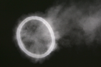 A smoke ring in the form of the number zero.