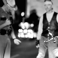 A cyclist performs a field sobriety test near the site of the Sturgis Motorcycle Rally