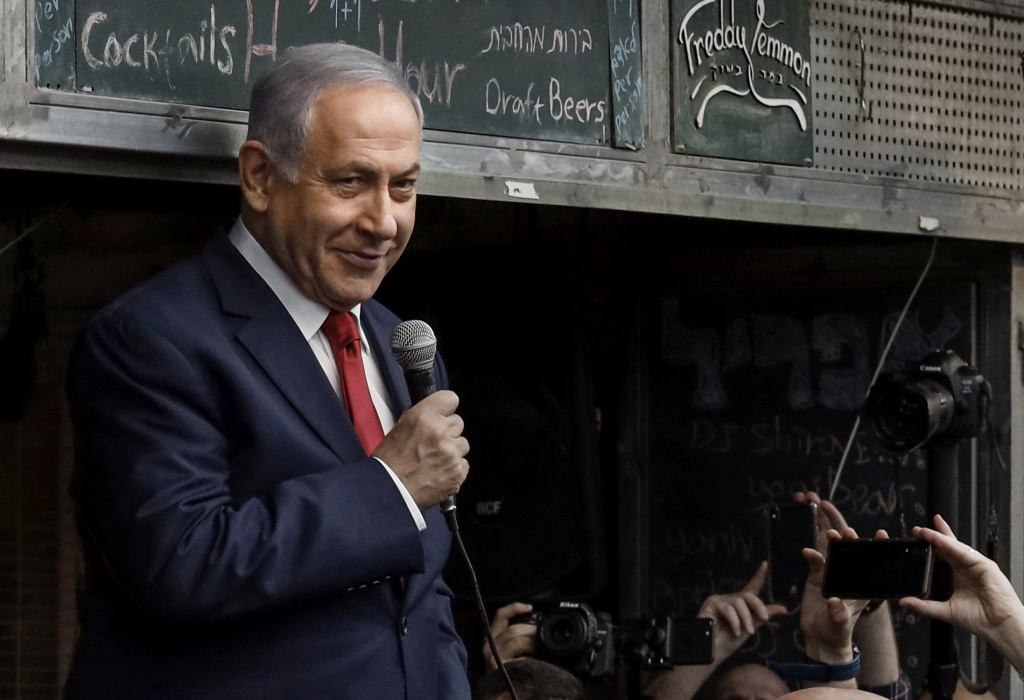 Israeli Prime Minister Benjamin Netanyahu, leader of the Likud party, addresses his supporters at the Machane Yehuda market in Jerusalem on April 8, 2019, a day ahead of the electoral polls