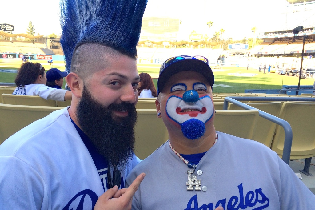 Robert Rocha (left) poses with fellow superfan Hiccups the Clown.