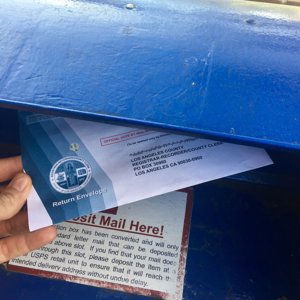A voter sends his absentee ballot in the mail on Monday. More than half of California voters send their ballots in by mail, according to the office of the California Secretary of State.