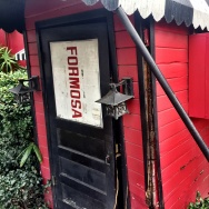 The front door of the historic but closed Formosa Cafe in West Hollywood is held closed, kinda, with a rope.