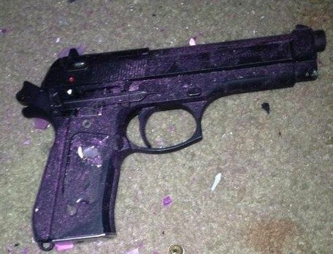 Handgun recovered at the scene of an 8-hour standoff on Saturday, June 23, 2012.