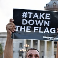 Hundreds of people gather for a protest rally against the Confederate flag in Columbia, South Carolina on June 20, 2015. The racially divisive Confederate battle flag flew at full-mast despite others flying at half-staff in South Carolina after the killing of nine black people in an historic African-American church in Charleston on June 17. Dylann Roof, the 21-year-old white male suspected of carrying out the Emanuel African Episcopal Methodist Church bloodbath, was one of many southern Americans who identified with the 13-star saltire in red, white and blue.