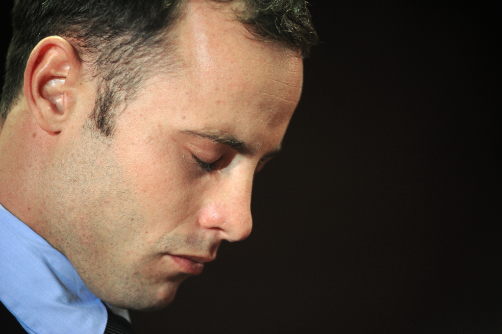 South African Olympic sprinter Oscar Pistorius is pictured at the Magistrate Court in Pretoria on February 22, 2013. Pistorius battled to secure bail as he appeared on charges of murdering his model girlfriend Reeva Steenkamp on February 14, Valentine's Day. South African prosecutors will argue that Pistorius is guilty of premeditated murder in Steenkamp's death, a charge which could carry a life sentence. Pistorius denies the charge, saying that he shot 29-year-old Steenkamp repeatedly through a locked bathroom door in the dead of night by accident, having mistaken her for a burglar.