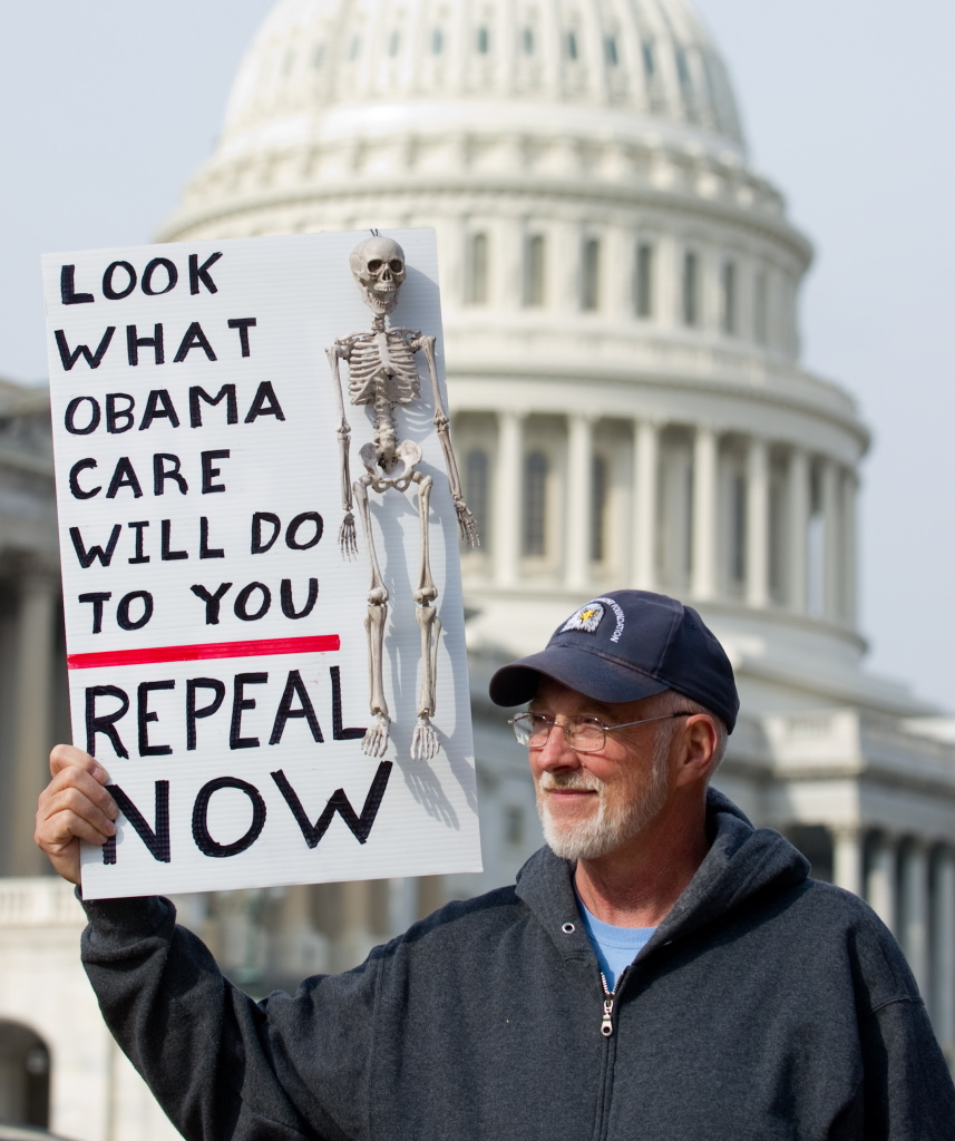 A man protests against the recent healthcare legislation as he attends a Tea Party protest against Democrats and U.S. President Barack Obama in Washington, D.C., Nov. 15, 2010.
