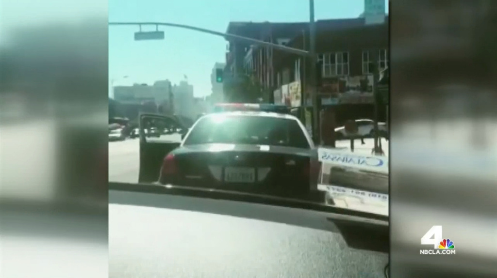 A screenshot from a video that police initially thought was a threat against LAPD officers, but ended up being a promotional stunt by 1990s rap group Brownside.
