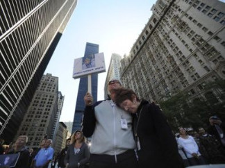 A couple holds a sign with a photo of James Patrick White, who died in the Sept. 11 terrorist attacks, during a memorial service commemorating the ninth anniversary of the Sept. 11 terrorist attacks on the World Trade Center Saturday, Sept. 11, 2010 in New York.