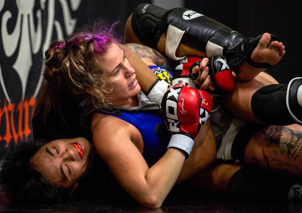 Professional fighter Gina Mazany practices during a training session at Xtreme Couture Mixed Martial Arts in Las Vegas. She well remembers her first concussion — which came in her first fight.