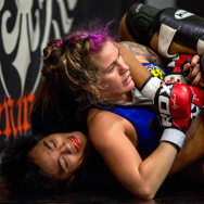"Professional fighter Gina Mazany practices during a training session at Xtreme Couture Mixed Martial Arts in Las Vegas. She well remembers her first concussion — which came in her first fight. ""I was throwing up that night, Mazany says."