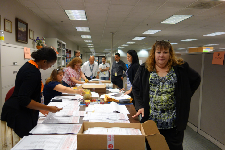 Richard Rios, an attorney with the Betty Yee campaign for state controller, reviews a ballot being recounted by hand at the Kern County Registrar of Voters office July 11, 2014.