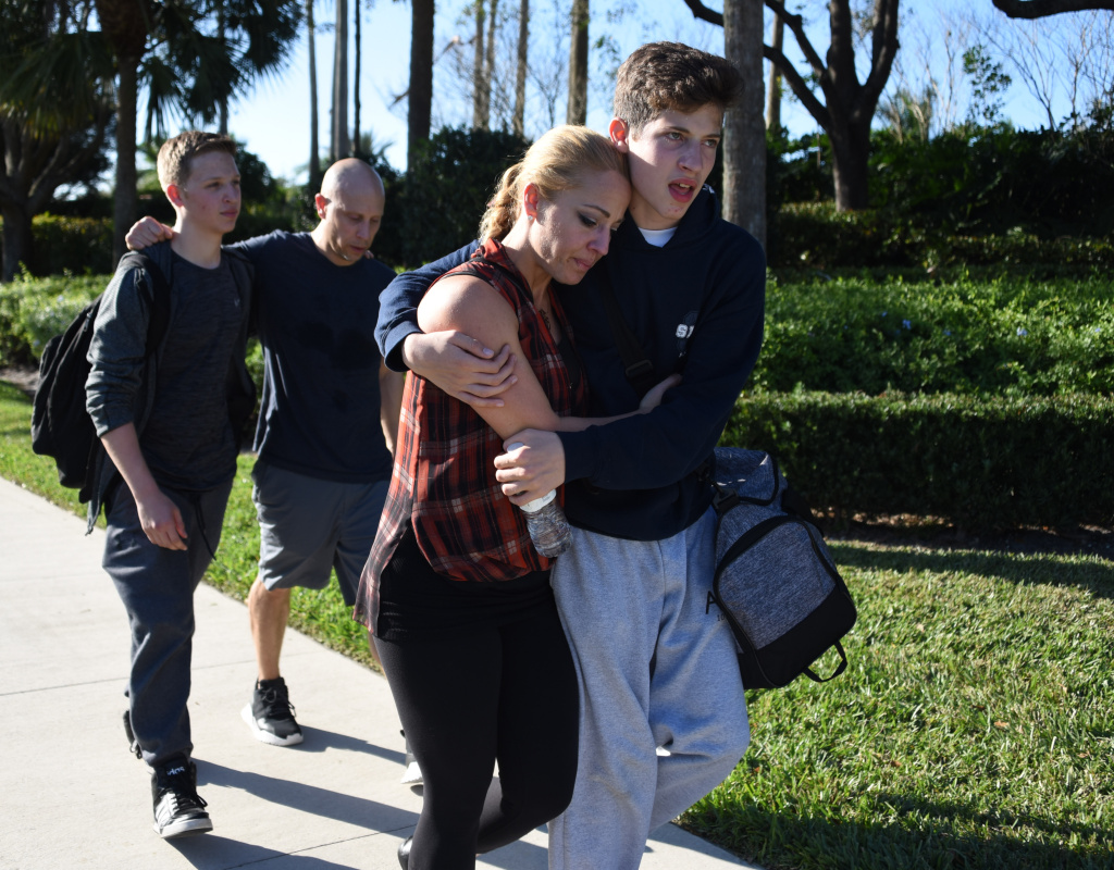 Students react following a shooting at Marjory Stoneman Douglas High School in Parkland, Florida, a city about 50 miles north of Miami on Feb. 14, 2018.