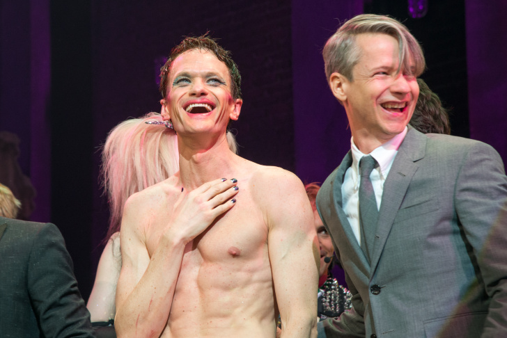 Neil Patrick Harris and John Cameron Mitchell during the curtain call at the Broadway opening night of