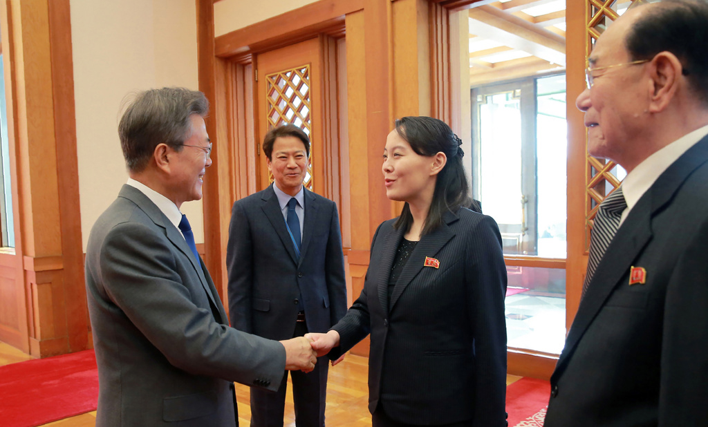 South Korea's President Moon Jae-in (left) greets Kim Yo Jong (center), the sister of North Korean leader Kim Jong Un, as North Korea's ceremonial head of state Kim Yong Nam (right) watches on February 10, 2018..
