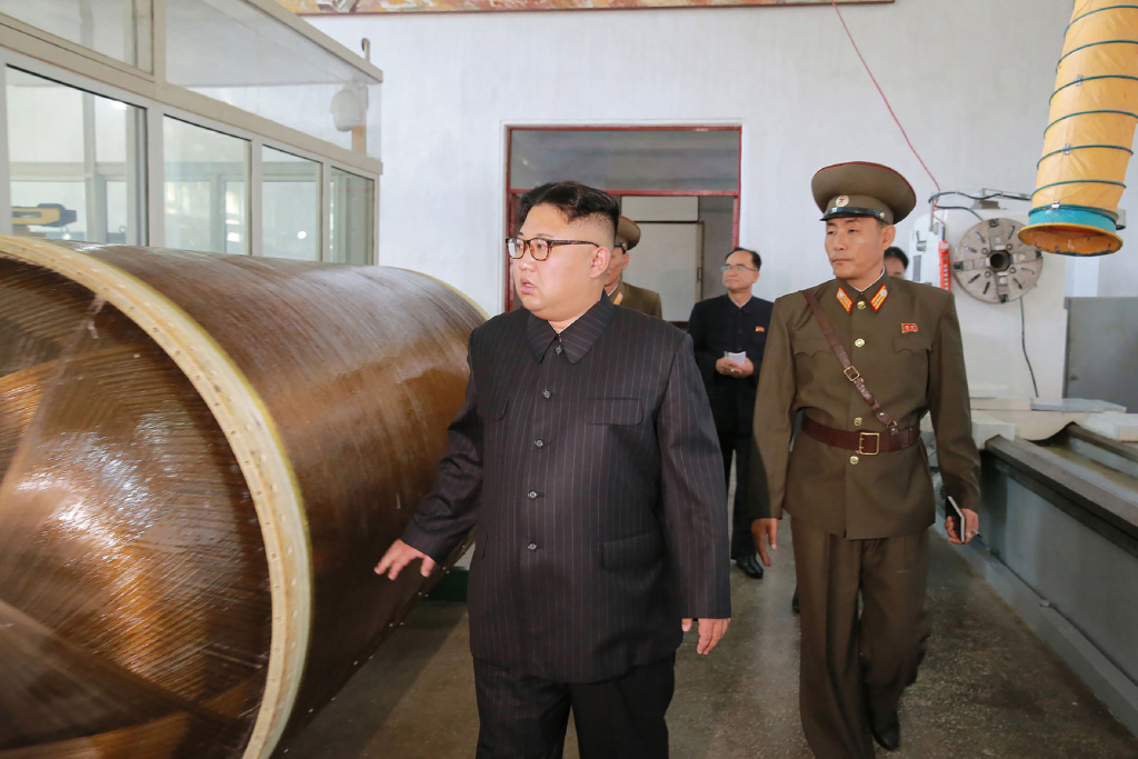 North Korean leader Kim Jong-Un visits the Chemical Material Institute of the Academy of Defense Science at an undisclosed location.