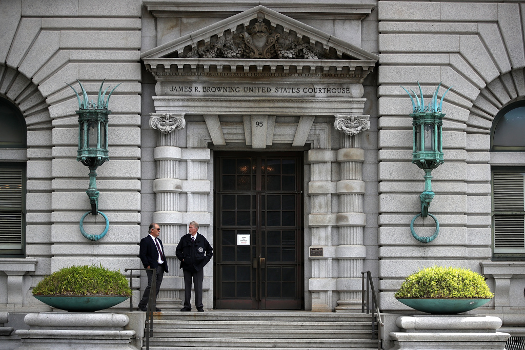 Security guards stand in front of the Ninth U.S. Circuit Court of Appeals  on June 12, 2017 in San Francisco, California.