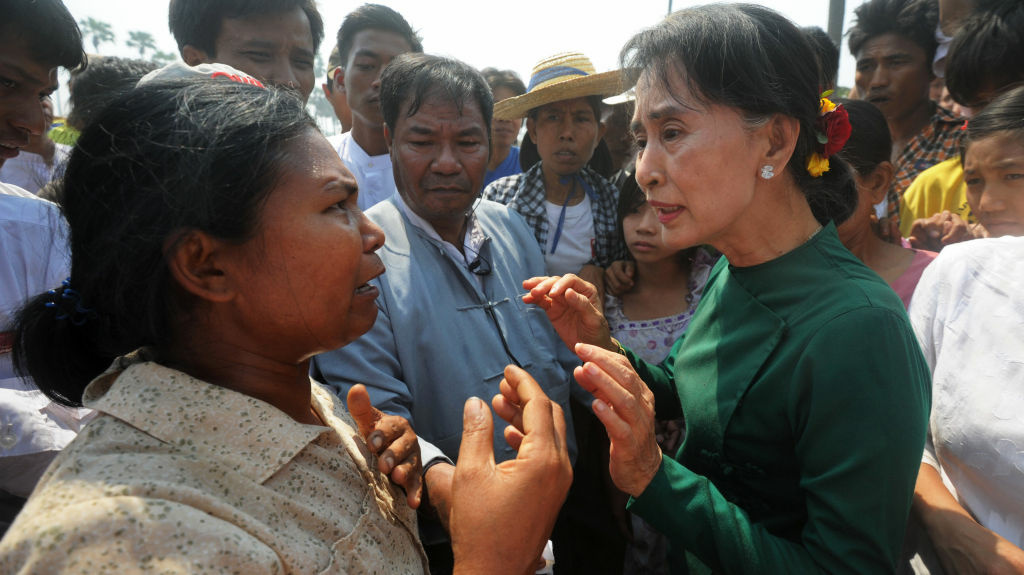 Aung San Suu Kyi (right) faced protesters when she traveled to a village in northern Myanmar on Thursday to discuss a Chinese-backed copper mine project. Suu Kyi, a Nobel laureate and a member of Parliament, urged protesters to support the project, which was the scene of a violent crackdown last year. She said opposing the project would risk hurting the country's economy.