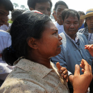 Aung San Suu Kyi (right) faced protesters when she traveled to a village in northern Myanmar on Thursday to discuss a Chinese-backed copper mine project. Suu Kyi, a Nobel laureate and a member of Parliament, urged protesters to support the project, which