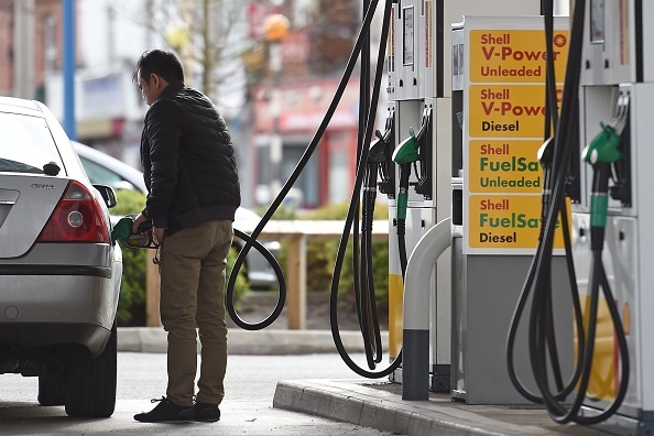 File: A man fills up his car from a petrol pump at a garage in Ellesmere Port in north west England on March 21, 2017.