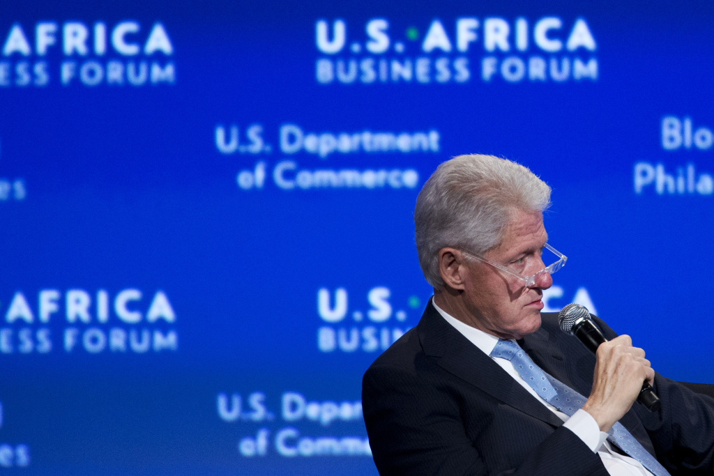 Former President Bill Clinton moderates the panel,