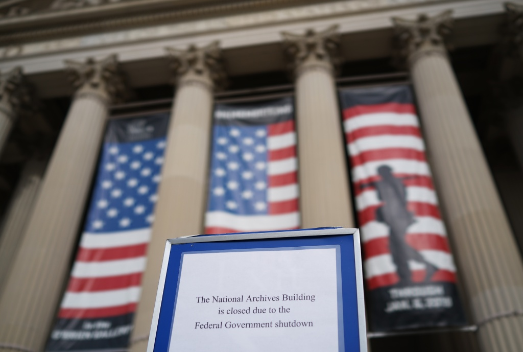 A notice alerting visitors that the building is closed is seen outside of the National Archives on the first full week of the government shutdown in Washington, DC on January 22, 2018.