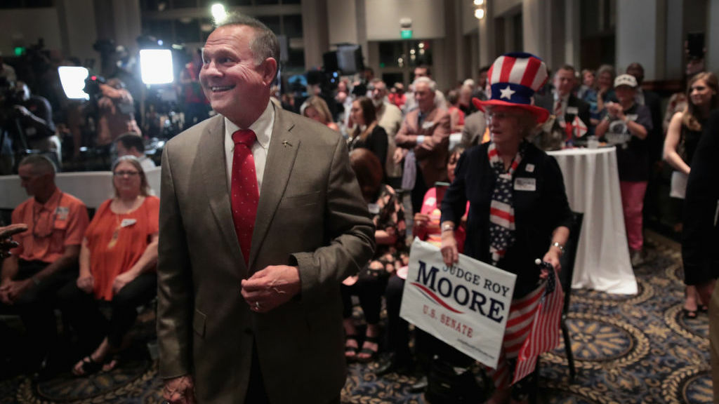 Alabama GOP Senate nominee Roy Moore greets supporters at his victory party on Tuesday night.