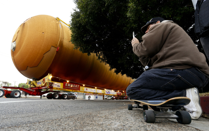 The space shuttle external propellant tank is moved through the streets of Los Angeles on Saturday, May 21, 2016. The ET-94 will be displayed with the retired space shuttle Endeavour at the California Science Center. (AP Photo/Chris Carlson)