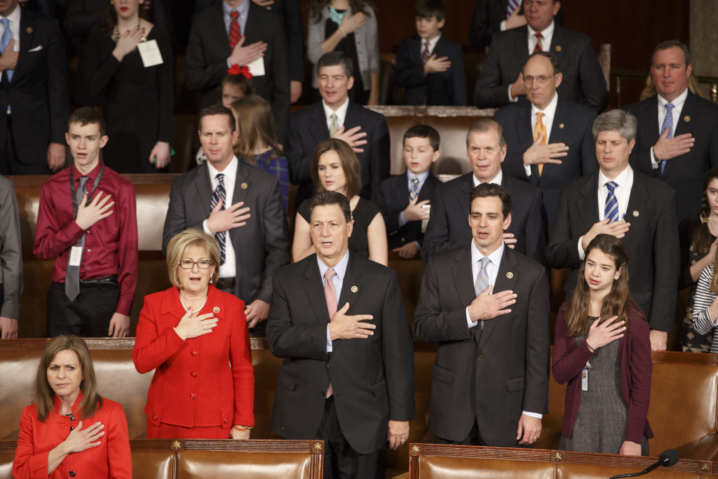 Members of the House of Representatives, many with their families, stand for the Pledge of Allegiance as they gather for the opening session of the 114th Congress on Capitol Hill in Washington, Tuesday, Jan. 6, 2015. House Speaker John Boehner of Ohio, is expected to win a third despite a tea party-backed effort to unseat him, and Sen. Mitch McConnell, R-Ky., ascends to majority leader of the Senate after Democrats lost control the wake of November's midterm elections.
