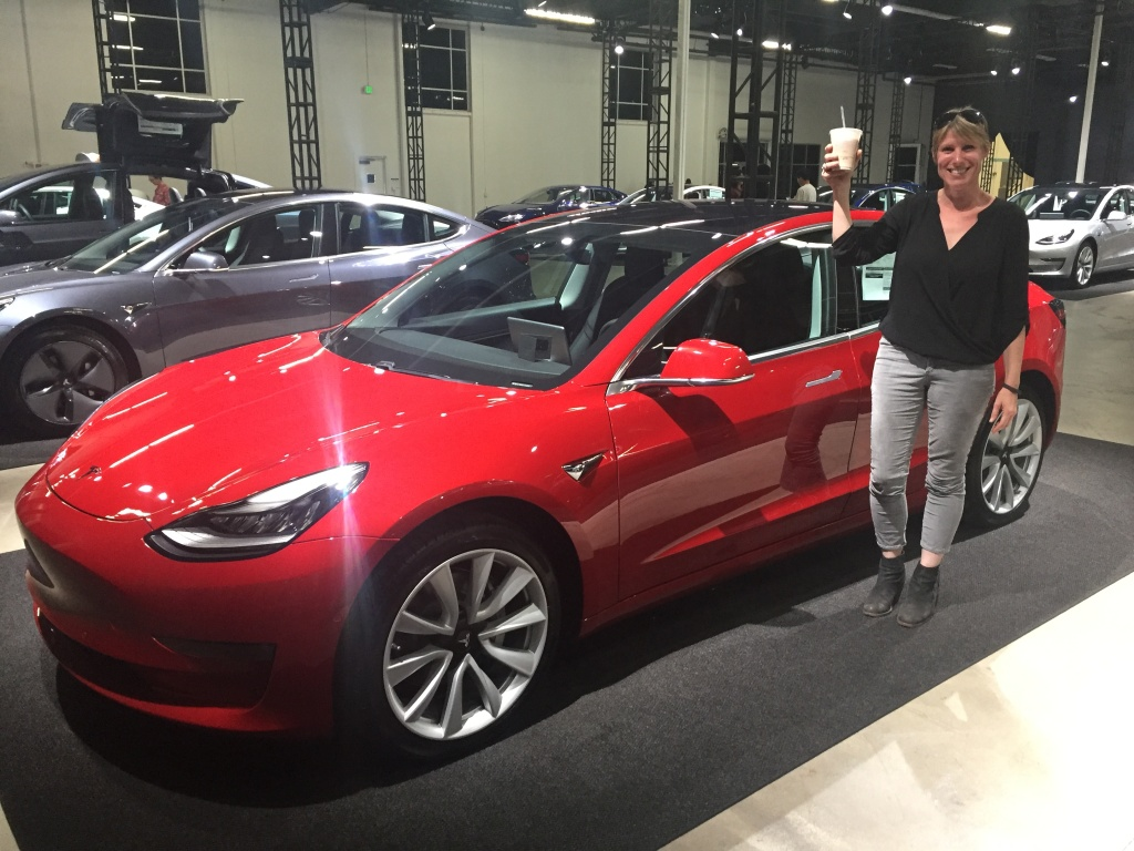Sue Carpenter with her Tesla Model 3 at the Tesla delivery center in Marina Del Rey.