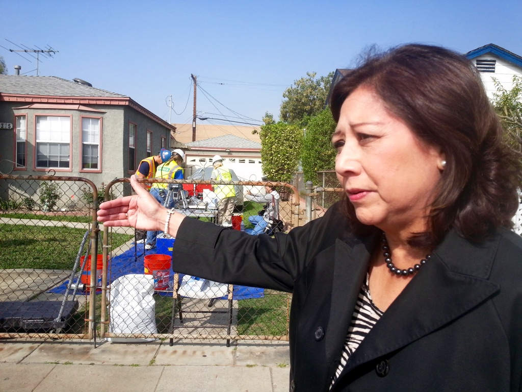 Los Angeles County Supervisor Hilda Solis visits work crews testing soil in Commerce for lead contamination from the former Exide battery recycling plant in nearby Vernon.