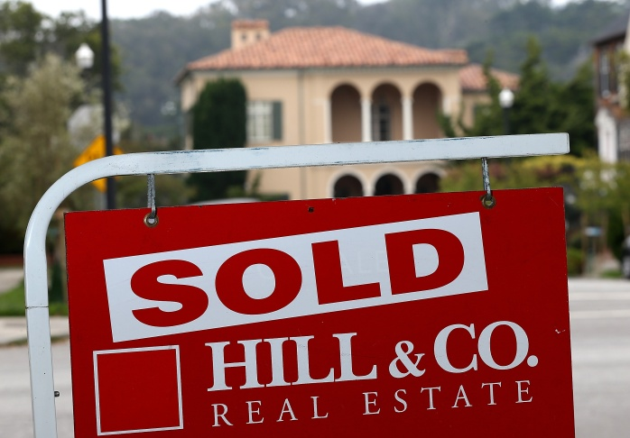 A sold sign is posted in front of a home for sale on July 30, 2013 in San Francisco, California.
