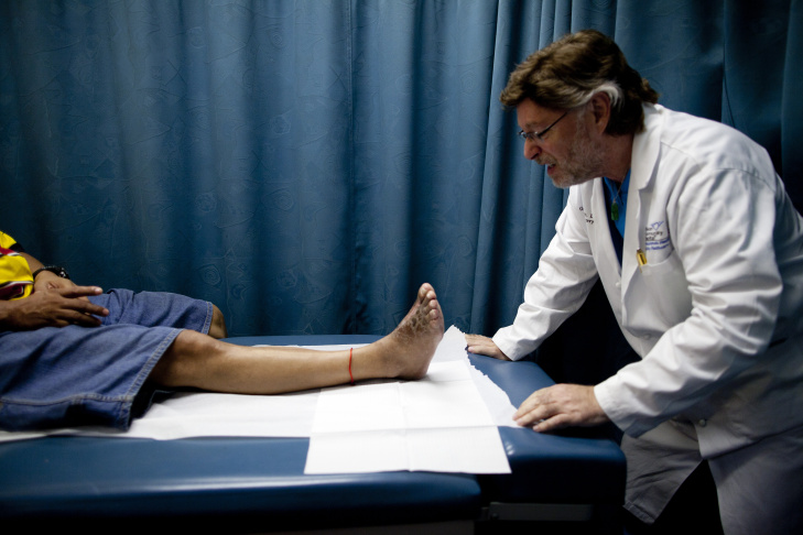 Dr. Gabriel Halperin examines a patient's foot at the New Hope Podiatry Clinic in East Los Angeles. The clinic focuses on wound care and limb preservation for diabetic patients.
