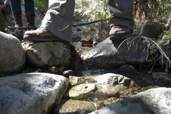 A Heal the Bay staff member straddles a portion of Cold Creek in the mountains north of Malibu.