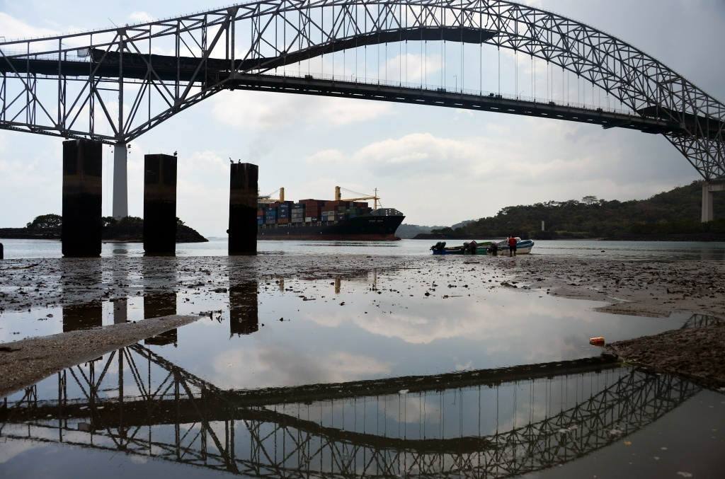 A cargo ship approaches the Bridge of America at the Panama Canal, on February 4, 2014.