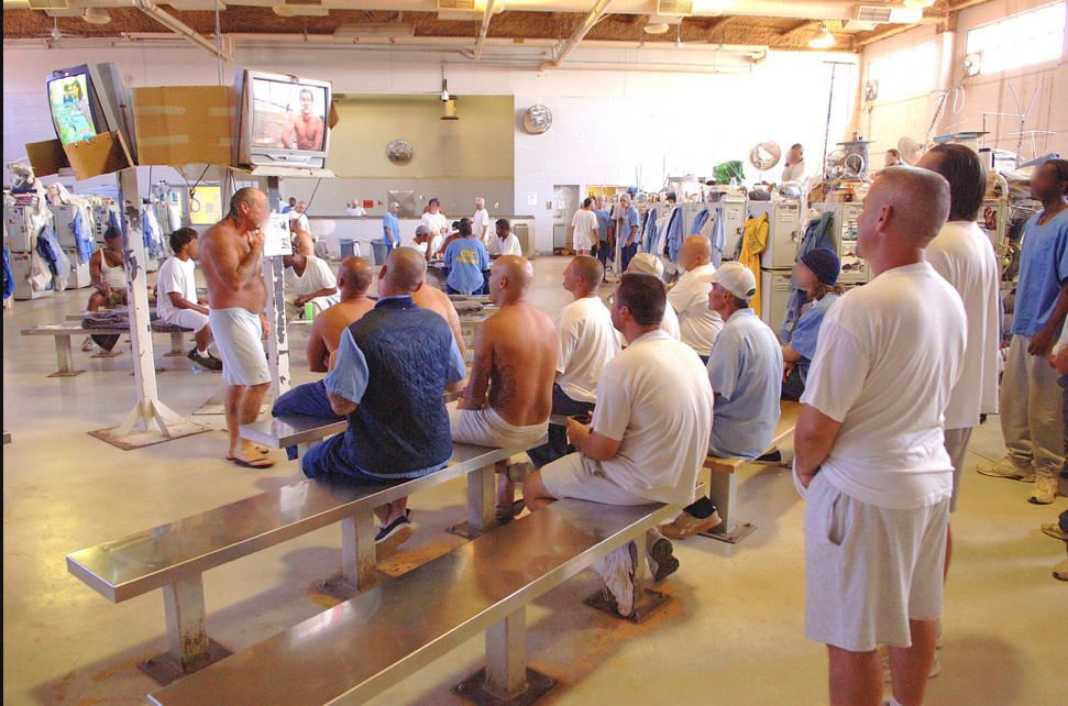 Men watch television in a recreation area at Solano Prison.