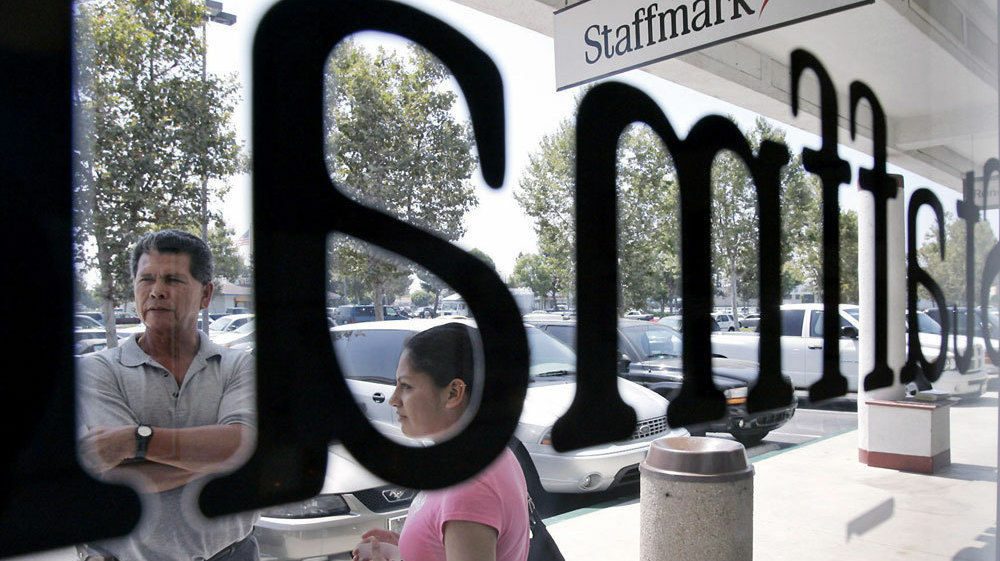 Job applicants outside the Staffmark temp agency in Cypress, Calif., in 2005. Temp hiring is usually a harbinger of an improving job market, but some analysts say more employers may be considering temps as a more permanent staffing solution.