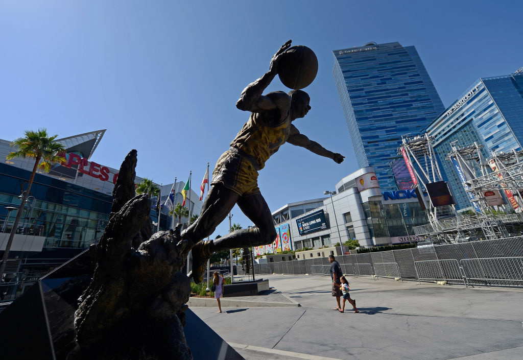 People walk by the L.A. Live entertainment complex, which includes the Staples Center and Nokia Theater, on September 19, 2012 in Los Angeles, California.