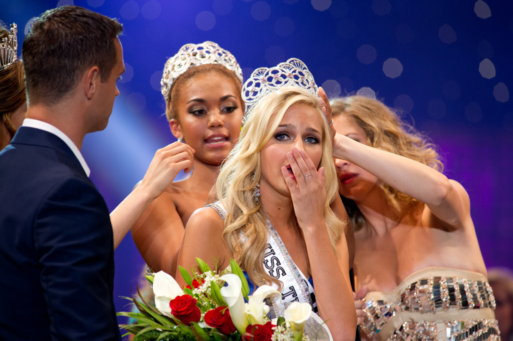 Miss California Teen USA 2013, Cassidy Wolf, is crowned Miss Teen USA 2013. She celebrates on stage after the crowning with show Hosts Karl Schmidt, Miss Teen USA 2003, Tami Farrell and Miss Teen USA 2012, Logan West, from Atlantis, Paradise Island and Resort in The Bahamas on Saturday, Aug. 10, 2013.
