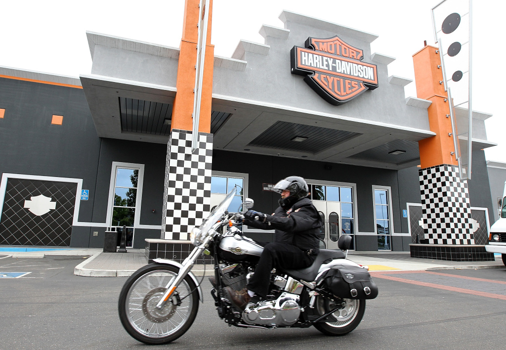 A man rides his Harley-Davidson motorcycle in front of Oakland Harley-Davidson on July 19, 2011 in Oakland, California.