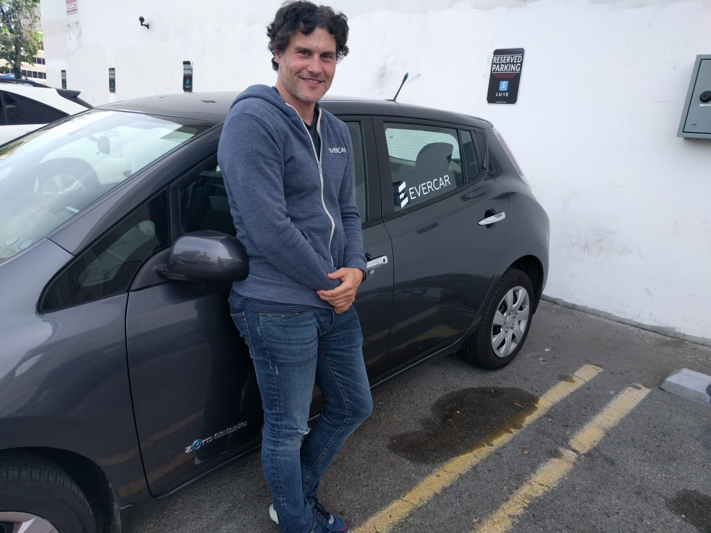 EverCar founder Michael Brylawski stands next to one of the Nissan Leafs available through the service. Cars can be rented specifically to drive for an Uber or Lyft shift through EverCar.